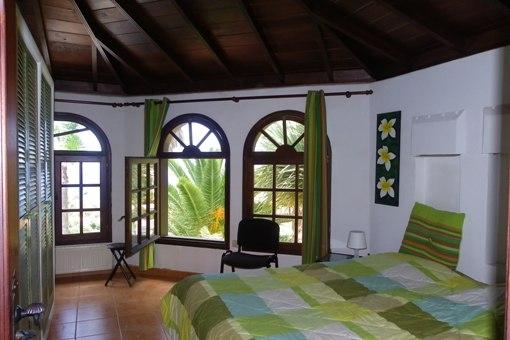Schlafzimmer mit rustikalem Ambiente