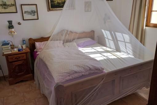 Eines von vier Schlafzimmern