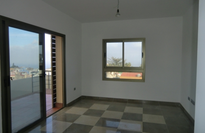Großes Wohnzimmer mit Essbereich sowie Teide- und Meerblick