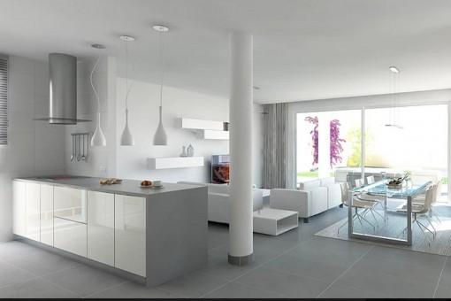 Blick von der Küche auf den hellen Wohn- und Essbereich