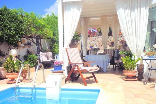 Helles 5-Zimmer Haus mit beheiztem Schwimmbad, Sauna und Meerblick in Puerto del Carmen