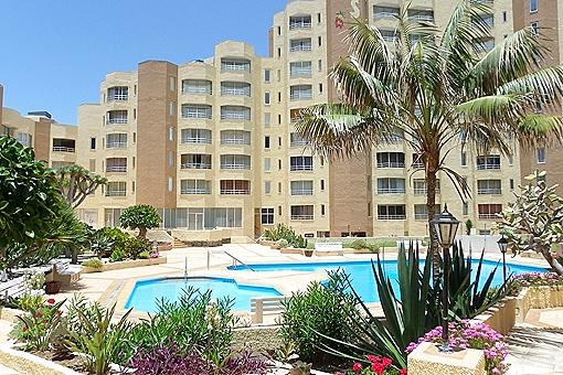 Apartment mit großer Terrasse und Pool in erster Meereslinie in Los Silos