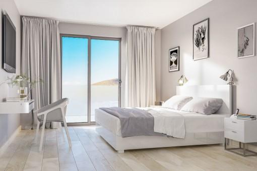 Helles Doppelschlafzimmer mit schönem Ausblick